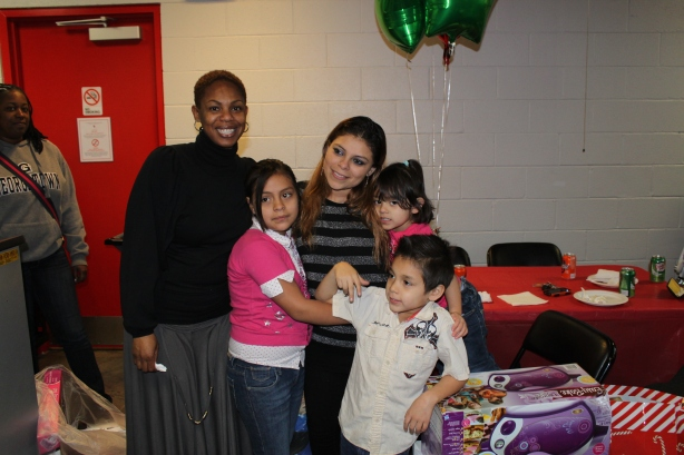 Social Worker Yoland Ugorji with Victoria Rodriquez and 3 of her Chidren
