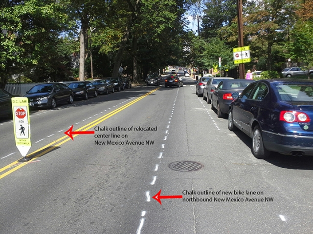 Chalk outlines of the new northbound bicycle lane and the relocated center line on New Mexico Avenue NW.