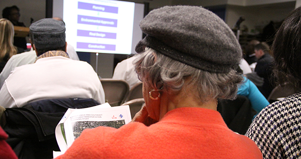 An attendee reads up on the agency's Barney Circle / Southeast Boulevard Transportation Study.