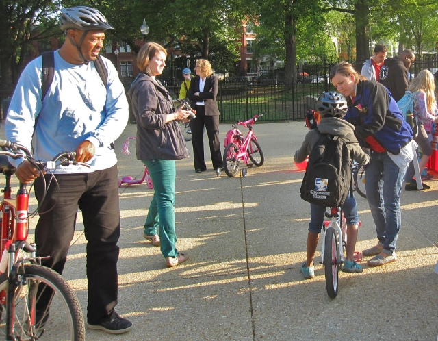 Safety first! A student participant in National Bike to School Day gets their helmet adjusted at DDOT's kick off at Lincoln Park.