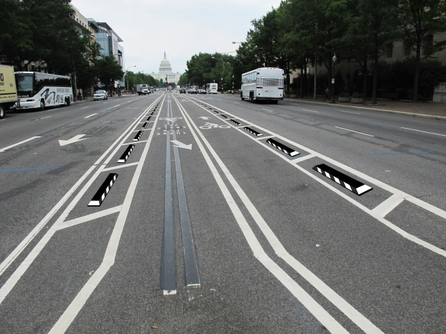 Recycled-rubber curbs will hopefully deter motorists from taking U-turns across the Pennsylvania Avenue cycletrack.