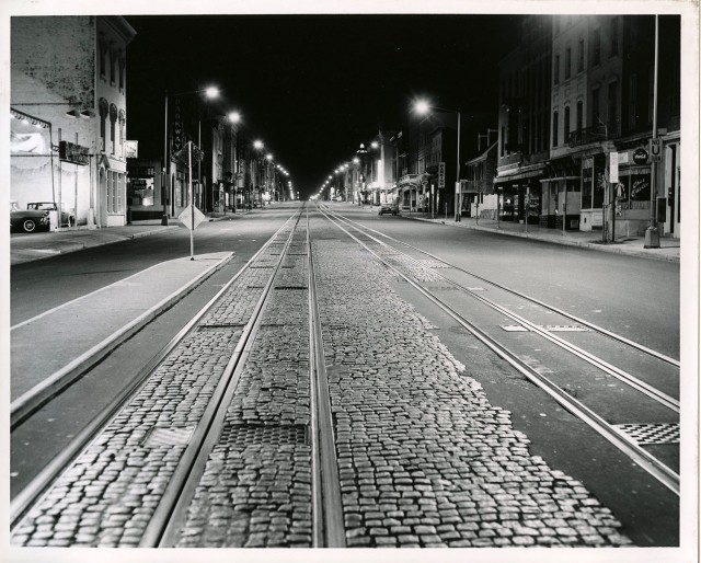 Streetcar tracks line M Street NW near 30th Street, circa December 8, 1959.