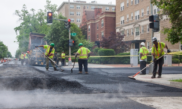 DDOT crews smooth freshly-laid asphalt on 16th Street NW.