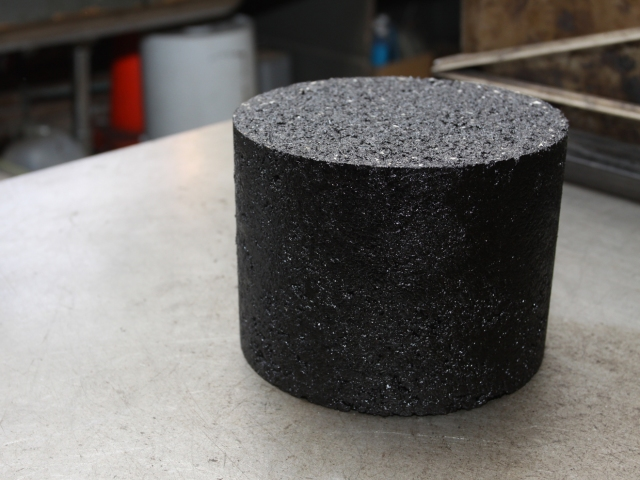 An asphalt sample after it has been spun into a cylinder by a gyratory compacter.